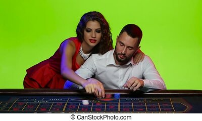 Girl tells the man to put on a number - At the poker table...