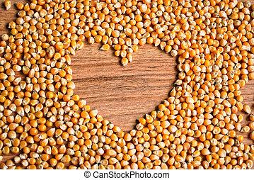 Popcorn Kernels Heart - Popcorn kernels with a heart shaped...