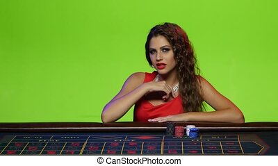 Luxury girl invited to bid in roulette - Luxury girl sitting...