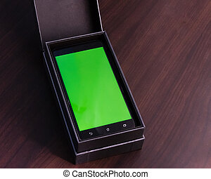 Smart phone with green screen in box - Smart phone with...