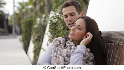Trendy attractive woman relaxing with her beau - Trendy...