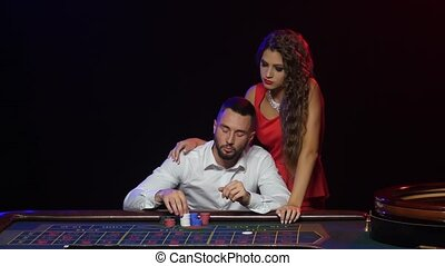Girl stops the man from the wrong rate. Roulette casino -...