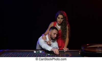 Winning the game of roulette. Young couple hit the jackpot -...