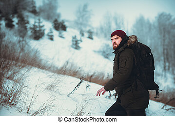 traveler goes through the woods at dawn - a man traveling...