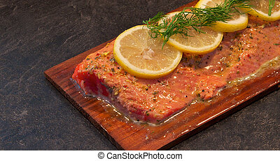 Sockeye salmon on cedar with lemon and dill - A filet of...