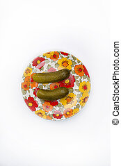 tow cucumbers on a flowery dish - Overhead shot of on tow...