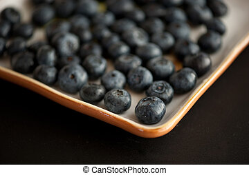 blue berries - A plate of fresh and delicious blue berries