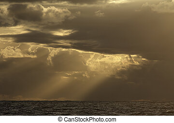 Stormy sea sky at sunset with interesting yellow light and...
