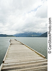 quiet lake - A wooden dock extendng into the lake in a...