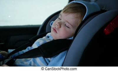 the baby is sleeping in the car in the way slowmotion