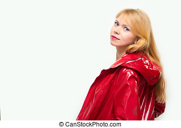 Girl in a raincoat - Young attractive girl in a varnish...