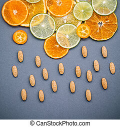Healthy foods and medicine concept. Pills of vitamin C and...