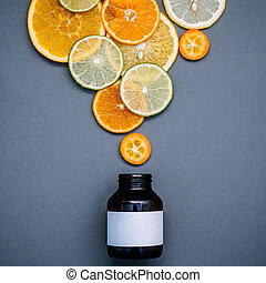 Healthy foods and medicine concept. Bottle of vitamin C and...