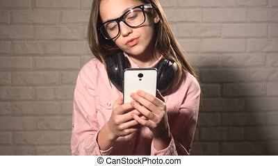 Teen girl messaging in smartphone - Teen cool girl in...