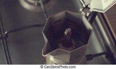 Preparing coffee in coffee geyser 4K