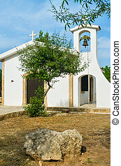 small chirch with tree - small Greek church with tree in...