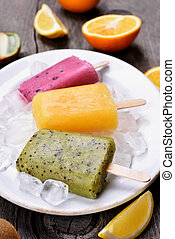 Popsicles from kiwi, orange, blueberry - Popsicles from...