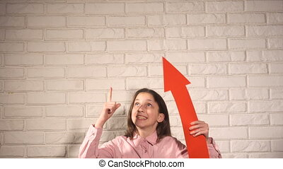 Teen girl in pink shirt show something by red arrow - Teen...