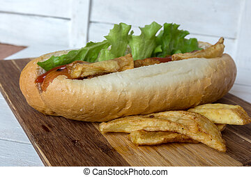 Barbecue Grilled Hot Dog with ketchup, french fries
