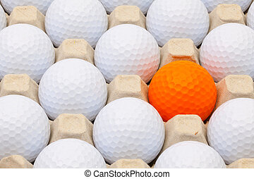 White and orange golf balls in the box eggs - White and...