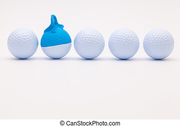 White golf balls with funny cap on the white background....