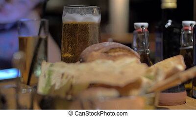 Beer and bread in cafe - Close-up shot of glass of beer in...