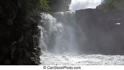 Waterfall among the rocks in Mauritius - Scenic view of...