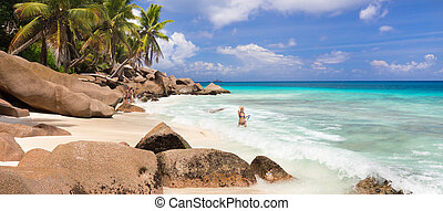 Woman enjoying Anse Patates picture perfect beach on La...