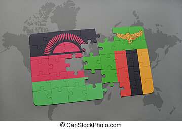 puzzle with the national flag of malawi and zambia on a...