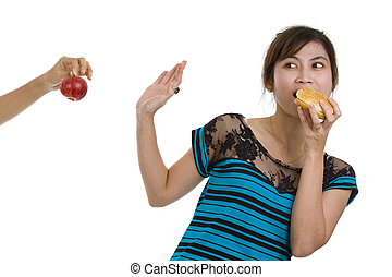 woman with hamburger refusing an apple