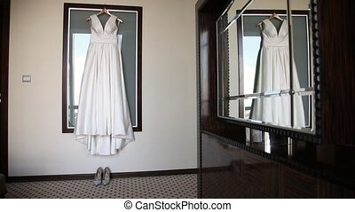 wedding dress weighing on the glass before ceremony