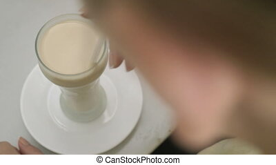 Woman drinking horchata in cafe - Woman drinking horchata...
