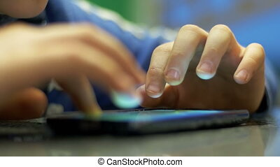 Hands Child Playing with Mobile Phone on the Table - Child...