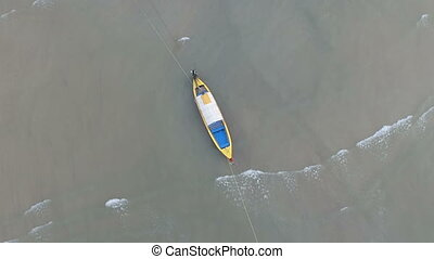 Aerial view of moored fishing boat in the sea waters of...