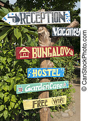 Hostel signs with nature background on Gili Air Island, Bali