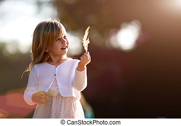 little girl 4 years old, blond hair, sunny day - Summer,...