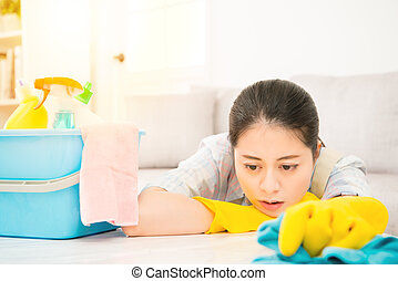 Tired woman holding rab with detergents - Tired attractive...