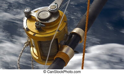 Fishing tackle on sailing motor boat - Close-up shot of...
