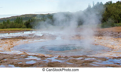 The famous Strokkur Geyser - Iceland - Close-up - The famous...