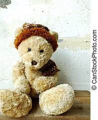 teddy bear on grung wallpaper background with copy space
