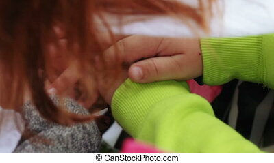 Stacked hands of children - Group of children with hands...