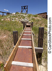 Old gold mining sluice and head frame.
