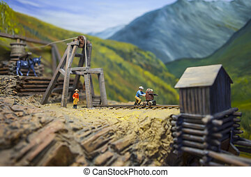 Mining model with tiny people, head frame and ore cart...