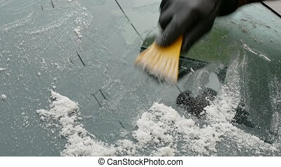 Automotive, ice cleaning from windshield - Winter scene,...