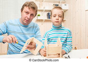 caring father teaches his son to build a bird feeder