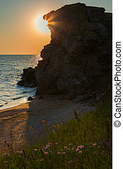 Sun rises over the Sea of Azov on Generals beach. Karalar...