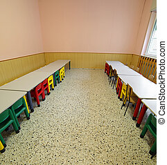 lunchroom with tables and small chairs for children -...