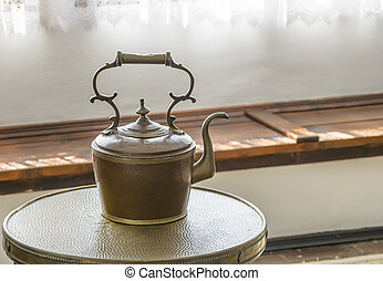 Old kettle on the table. - Black iron asian style teapot...