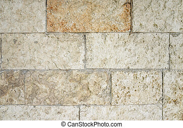 Wall of stone blocks. - Detail of a wall of stone blocks.