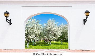 Door arch spring garden - doorway arch with a flashlight on...